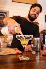 Roy Haack, manager at Farmhouse Tacos, makes an example of a Classic Margarita for photographs Wednesday, Dec. 12, 2018. The drink will be offered at Farmhouse Pizza.