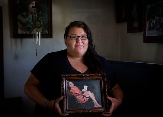 Kimberly Loring Heavy Runner holds a photo of her sister, Ashley, who went missing on the Blackfeet Reservation in 2017.