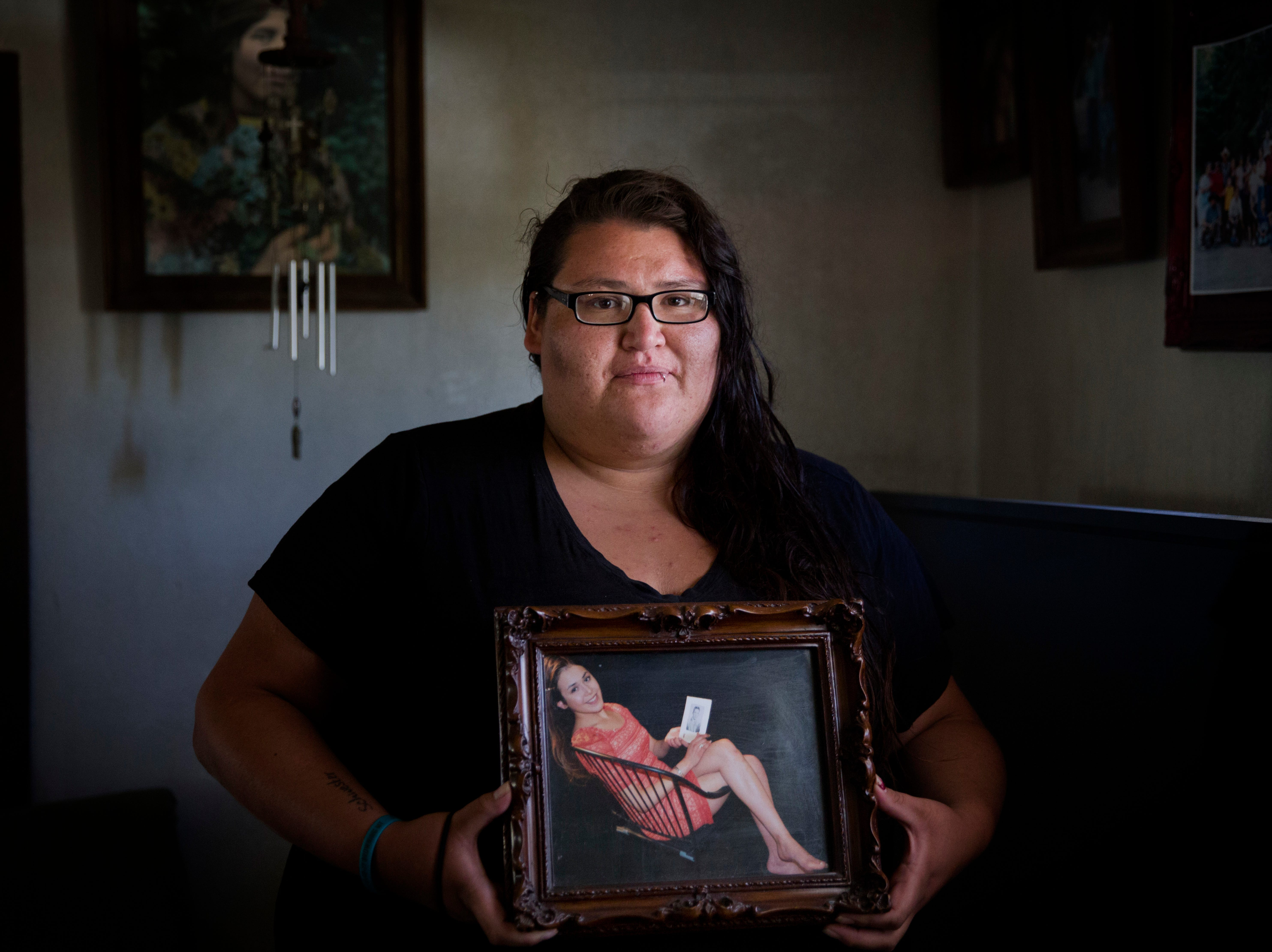 "In this July 13, 2018, file photo, Kimberly Loring holds a photo of her sister, Ashley HeavyRunner Loring, who went missing on the Blackfeet Indian Reservation as she stands in her grandmother's home in Browning, Mont. Loring, the sister of a missing Blackfeet woman in Montana is expressing frustration over police's initial response to her loved one's disappearance, telling U.S. senators in prepared testimony Wednesday, Dec. 12, 2018, that ""dysfunctional"" investigations into missing persons cases have troubled numerous Native American families."