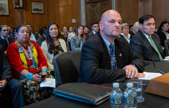 From left, Amber Crotty from Window Rock, Ariz., a delegate of the Navajo Nation Council, and Rep.-elect Deb Haaland, D-NM, the first Native American woman elected to Congress, listen to testimony by Charles Addington, deputy associate director of the Bureau of Indian Affairs, center, and Robert Johnson, right, assistant director of the FBI's Criminal Investigative Division, at a hearing by the Senate Committee on Indian Affairs to examine concerns about investigations into the deaths and disappearance of Native American women, on Capitol Hill in Washington, Wednesday, Dec. 12, 2018.