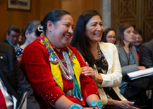 Amber Crotty from Window Rock, Ariz., left, a delegate of the Navajo Nation Council, and Rep.-elect Deb Haaland, D-NM, the first Native American woman elected to Congress, embrace each other during a hearing by the Senate Committee on Indian Affairs to examine concerns about investigations into the deaths and disappearance of Native American women, on Capitol Hill in Washington, Wednesday, Dec. 12, 2018.