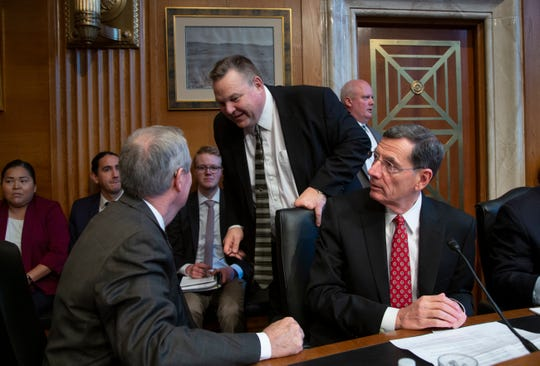 Sen. Jon Tester, D-Mont., center, confers with Sen. Mike Crapo, R-Idaho, left, and Sen. John Barrasso, R-Wyo., right, as the Senate Committee on Indian Affairs holds a hearing to examine concerns about investigations into the deaths and disappearance of Native American women, on Capitol Hill in Washington, Wednesday, Dec. 12, 2018.