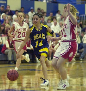 Box Elder's Kristie Pullin drives against Winifred in 2001. The point guard is among those named to the Tribune's GOAT girls' basketball list for Box Elder.