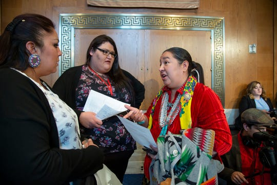 From left, Lissa Loring and Kimberly Loring from the Blackfeet Reservation in Montana, speak with Amber Crotty from Window Rock, Ariz., a delegate of the Navajo Nation Council, before testifying as the Senate Committee on Indian Affairs holds a hearing to examine concerns about investigations into the deaths and disappearance of Native American women, on Capitol Hill in Washington, Wednesday, Dec. 12, 2018. Kimberly Loring is the sister of Ashley Loring HeavyRunner, a 20-year-old college student, who disappeared from the Blackfeet Reservation in Montana in the summer of 2017.
