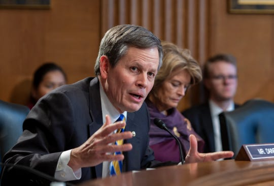 Sen. Steve Daines, R-Mont., joined at right by Sen. Lisa Murkowski, R-Alaska, addresses Kimberly Loring, whose sister, Ashley Loring HeavyRunner, a 20-year-old college student, disappeared from the Blackfeet Reservation in Montana in the summer of 2017, at a hearing by the Senate Committee on Indian Affairs to examine concerns about investigations into the deaths and disappearance of Native American women, on Capitol Hill in Washington, Wednesday, Dec. 12, 2018.
