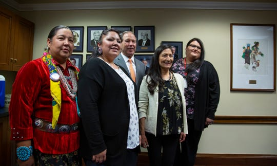 From left, Amber Crotty from Window Rock, Ariz., a delegate of the Navajo Nation Council, Lissa Loring, from the Blackfeet Reservation in Montana, Vice Chair of the Senate Committee on Indian Affairs Sen. Tom Udall, D-N.M., Rep.-elect Deb Haaland, D-NM, the first Native American woman elected to Congress, and Kimberly Loring, of the Blackfeet Reservation in Montana, meet before the start of an Indian Affairs hearing to examine concerns about investigations into the deaths and disappearance of Native American women, on Capitol Hill in Washington, Wednesday, Dec. 12, 2018.