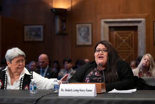 Kimberly Loring, right, whose sister, Ashley Loring HeavyRunner disappeared from the Blackfeet Reservation in Montana in 2017, is comforted by Patricia Alexander of the Tlingit and Haida Indian Tribes of Alaska, left, as the Senate Committee on Indian Affairs holds a hearing to examine concerns about investigations into the deaths and disappearance of Native American women, on Capitol Hill in Washington, Wednesday, Dec. 12, 2018.