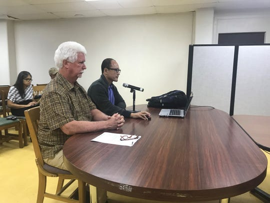 Richard Reed, front, and Kevin Shin propose plans for an eleven-story hotel directly across the A.B. Won Pat International Airport at the Guam-Hybrid Land Use Commission meeting in December 2018.