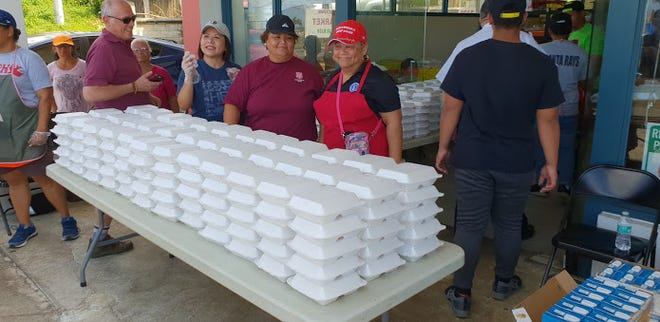 The Salvation Army distributes take-home meals to CNMI students. Students have recently returned to schools after Super Typhoon Yutu.