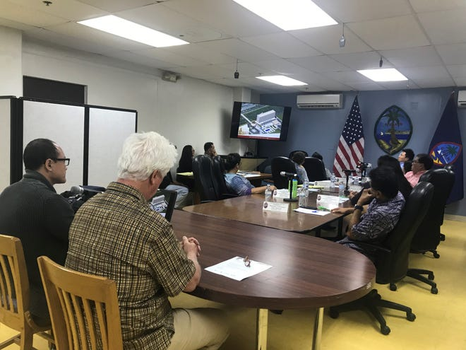 Applicant Kevin Shin and Richard Reed, from RNK Architecture, share plans for a 11 story hotel across the Guam airport to the Guam-Hybrid Land Use Commission on Thursday.