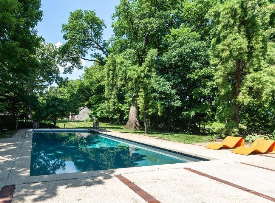 The property includes an in-ground pool and pool house.
