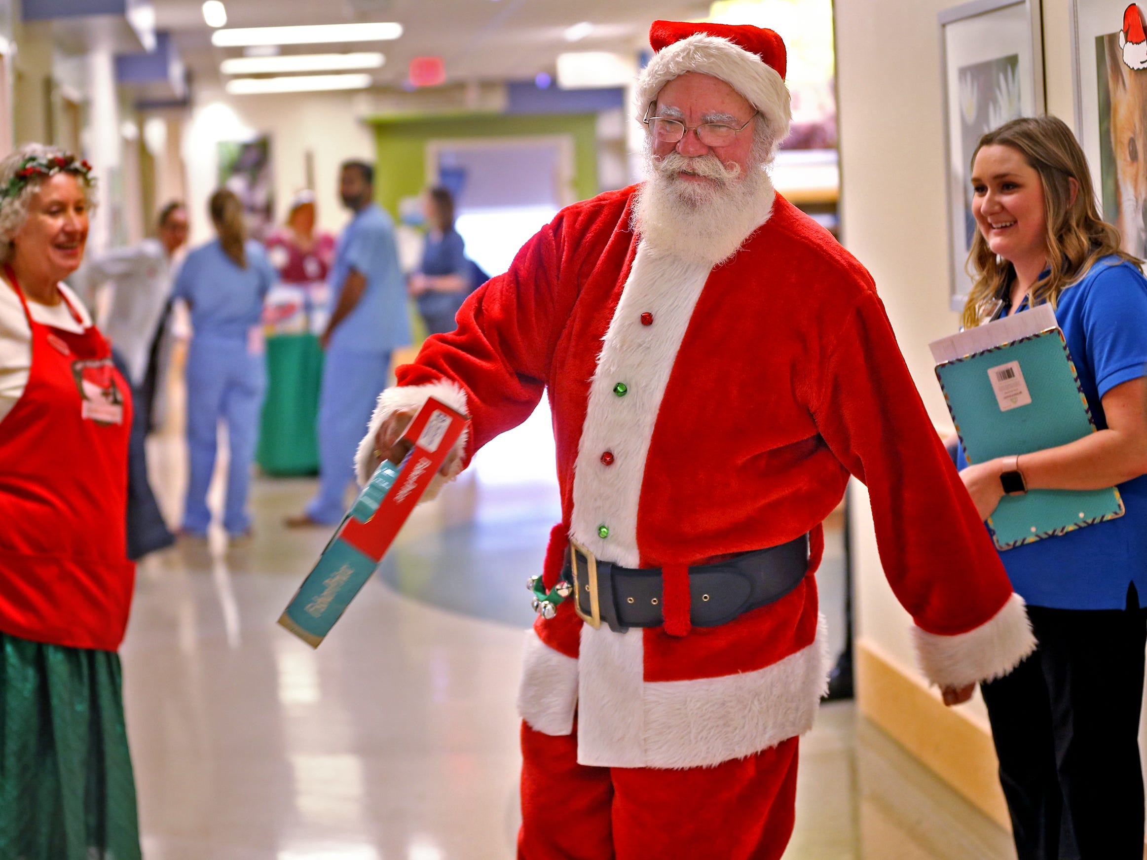 Santa and Mrs. Claus, aka Bill and Kathy Armstrong, visit with kids at Riley Children's Health, Thursday, Dec. 13, 2018.  In between two of the rooms, Santa danced.