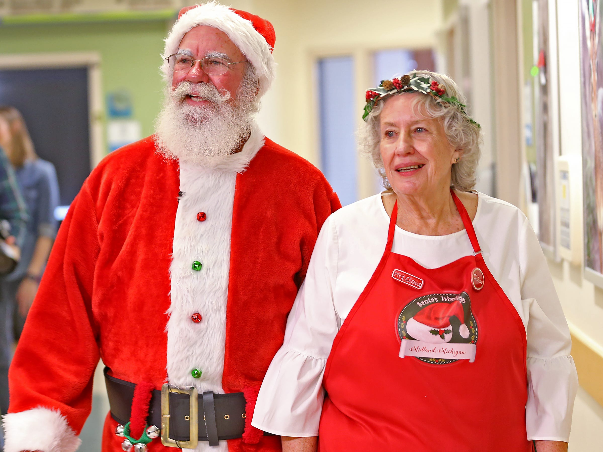 Santa and Mrs. Claus, aka Bill and Kathy Armstrong, visit with kids at Riley Children's Health, Thursday, Dec. 13, 2018.