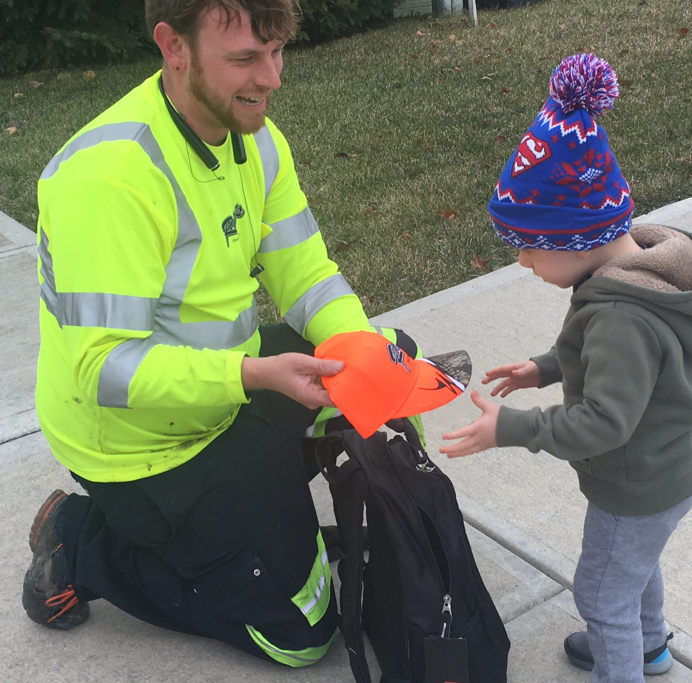 Ray's Trash Service driver surprises Plainfield toddler with backpack full of gifts