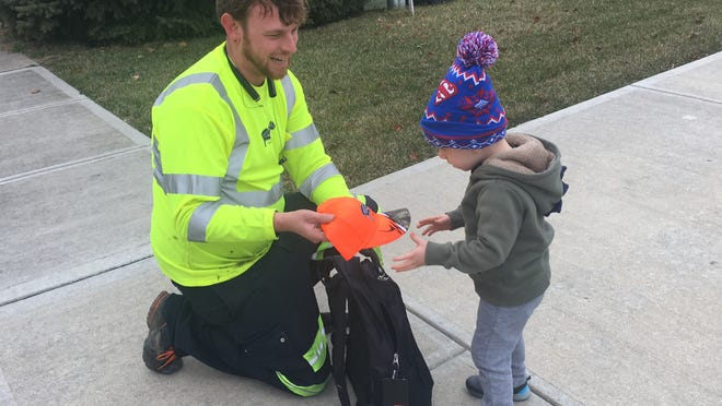 Evan Brenneman, 2, formed a fast friendship with his weekly trash man, James Bullock. On Dec. 13, Bullock surprised Evan with a backpack full of Ray's Trash Service goodies.