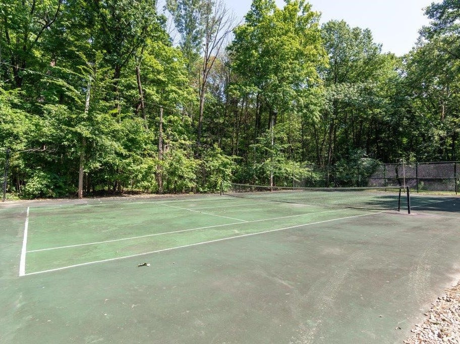 A tennis court sits on the property's 10 acres.