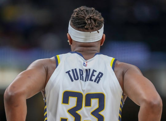 Indiana Pacers center Myles Turner (33) heads back onto the court for the fourth quarter against the Milwaukee Bucks on Wednesday, Dec. 12, 2018.