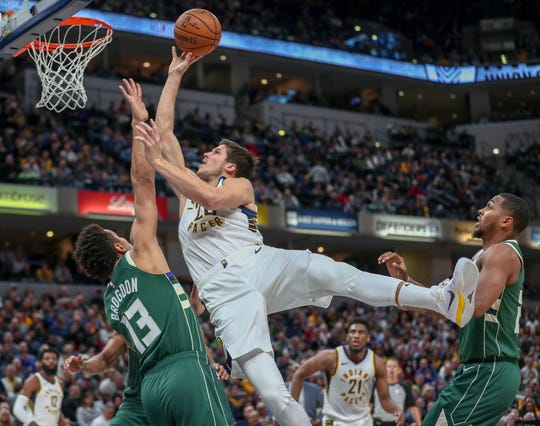 Indiana Pacers forward Doug McDermott (20) gets the shot to drop over Milwaukee Bucks guard Malcolm Brogdon (13) on Wednesday, Dec. 12, 2018.