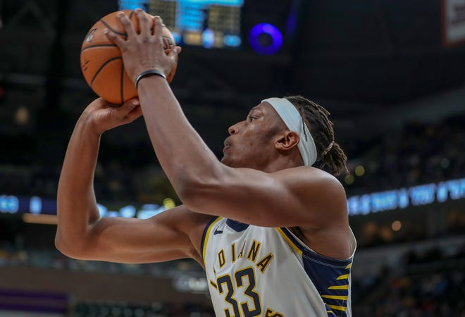 Indiana Pacers center Myles Turner (33) makes a three point shot from the corner against the Milwaukee Bucks on Wednesday, Dec. 12, 2018.