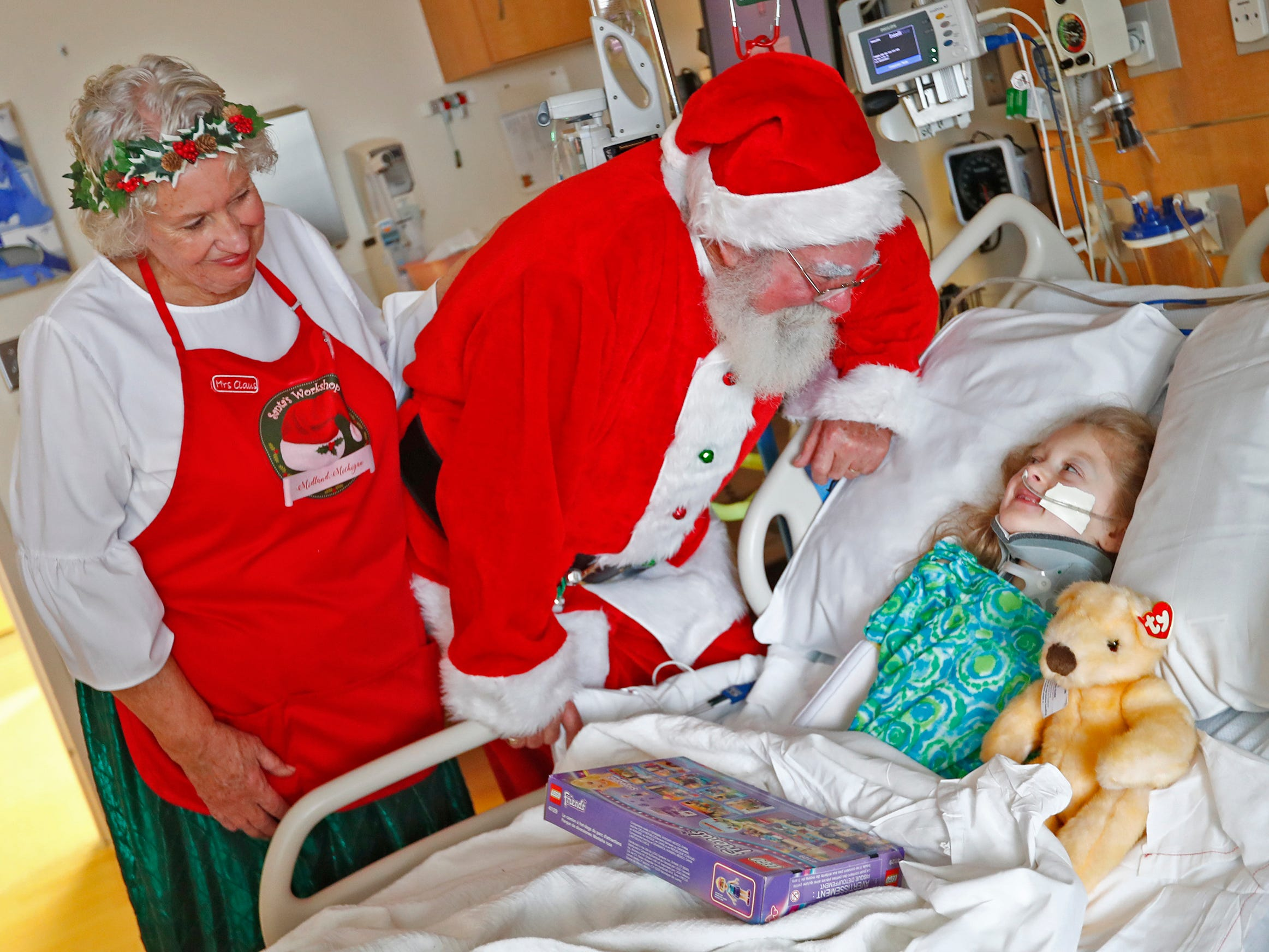 Santa and Mrs. Claus, aka Bill and Kathy Armstrong, talk with Leighton Gadbury, while they visit with kids at Riley Children's Health, Thursday, Dec. 13, 2018.