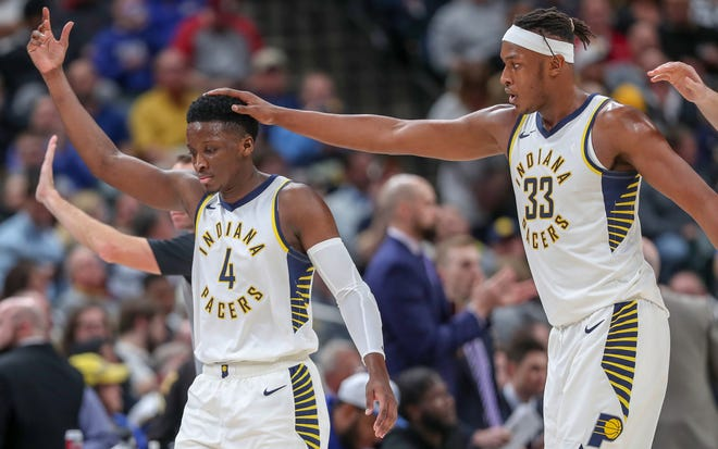 Indiana Pacers center Myles Turner (33) celebrates with guard Victor Oladipo (4) after the Milwaukee Bucks call a timeout on Wednesday, Dec. 12, 2018.