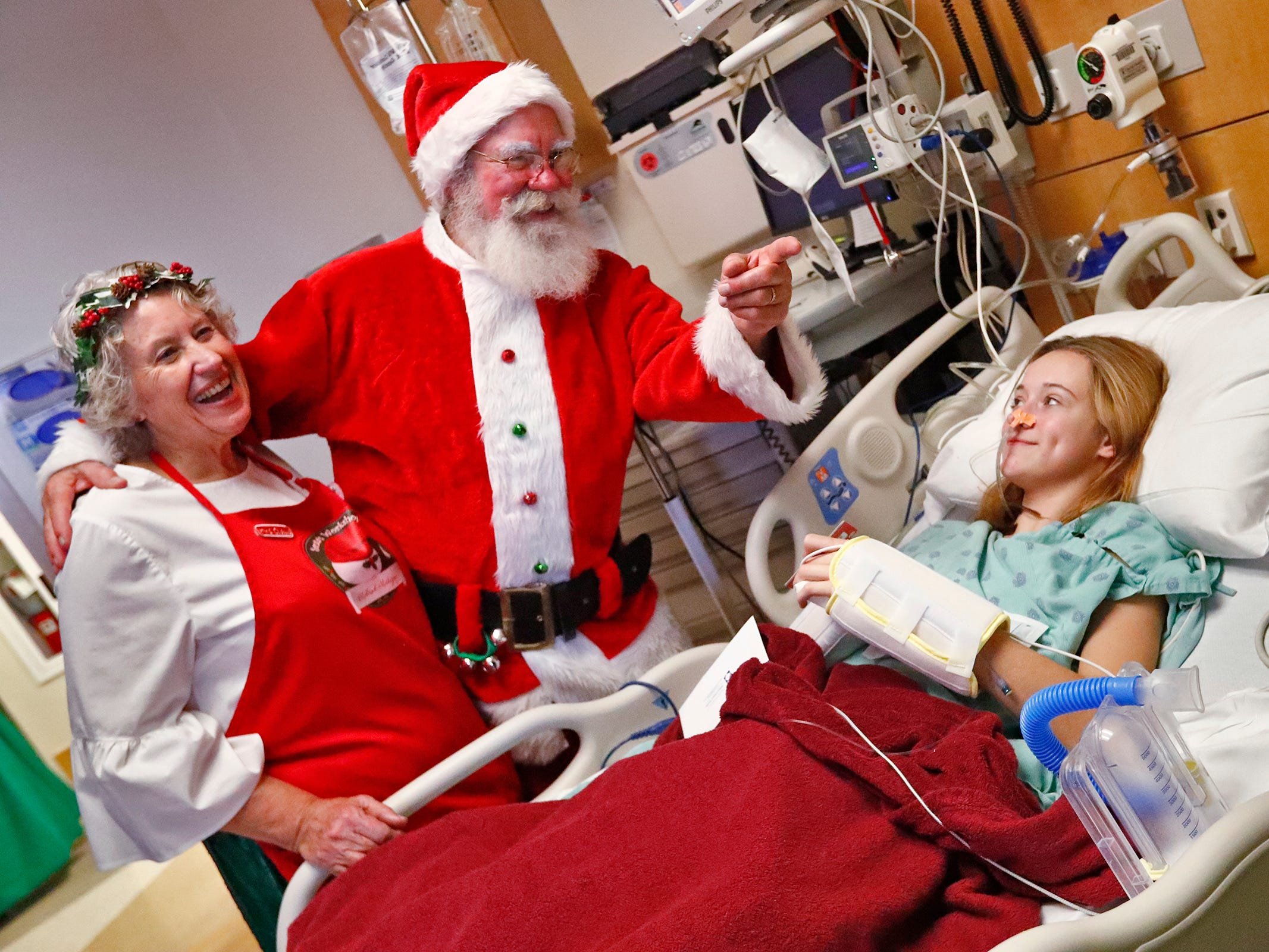 Santa and Mrs. Claus, aka Bill and Kathy Armstrong, talk with Ivy Abbott, while they visit with kids at Riley Children's Health, Thursday, Dec. 13, 2018.