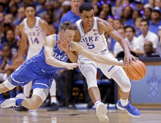 Duke's Alex O'Connell, left, and Jordan Tucker (5) chase the ball in the Blue-White scrimmage during the NCAA college basketball team's Countdown to Craziness event to kick off the season in Durham, N.C., Friday, Oct. 20, 2017.