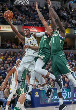 Indiana Pacers guard Victor Oladipo (4) goes up and gets the layup against the Milwaukee Bucks on Wednesday, Dec. 12, 2018.