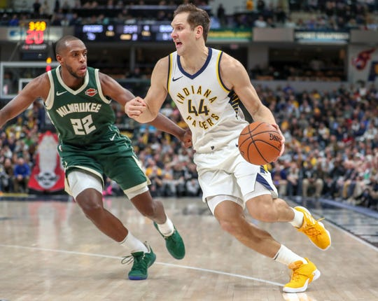 Indiana Pacers forward Bojan Bogdanovic (44) drives against Milwaukee Bucks forward Khris Middleton (22) on Wednesday, Dec. 12, 2018.