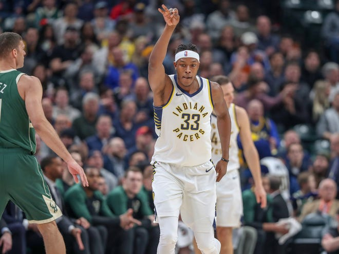 Indiana Pacers center Myles Turner (33) hits an early two point shot from outside against the Milwaukee Bucks on Wednesday, Dec. 12, 2018.