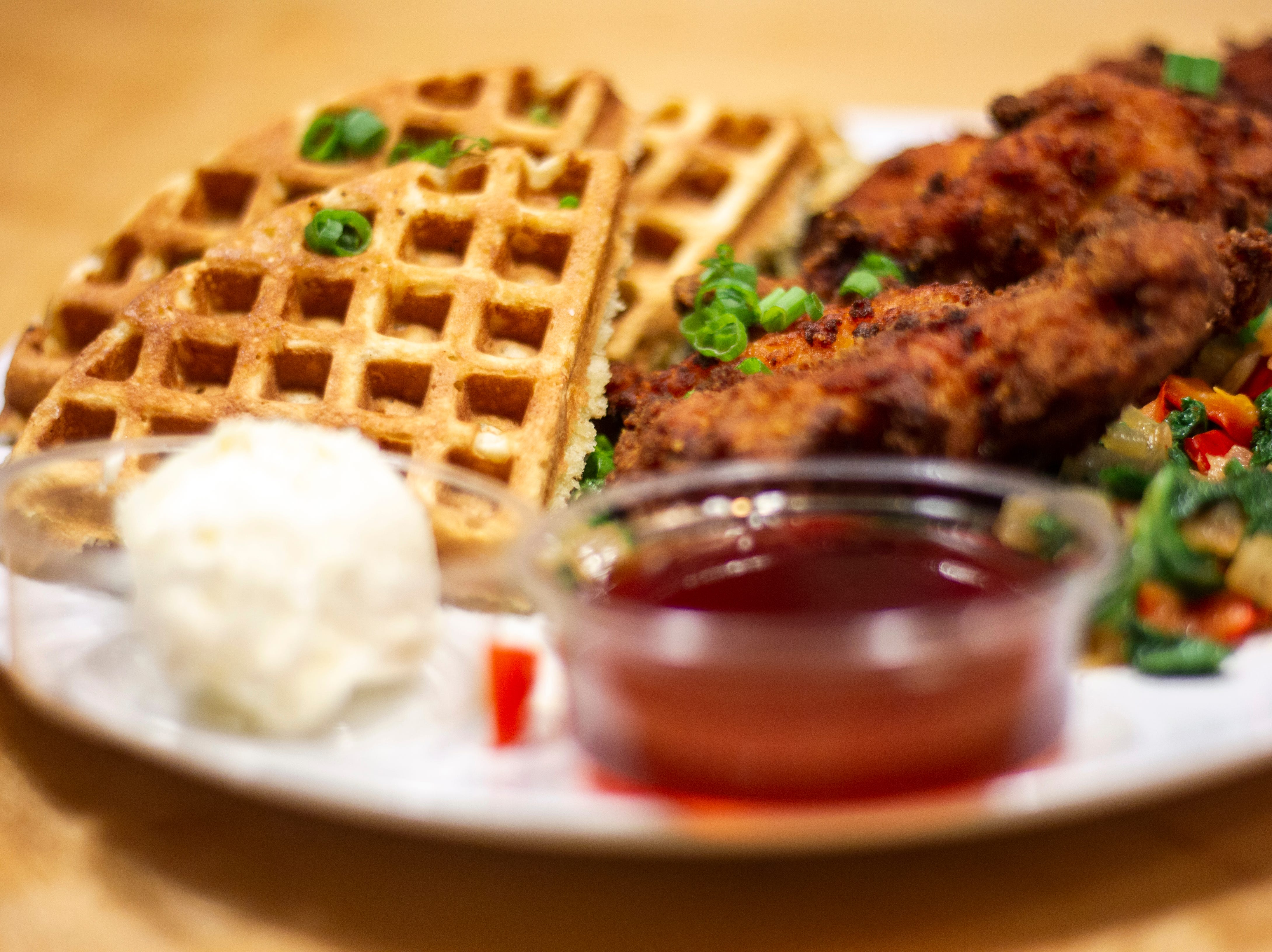 A plate of chicken and waffles is seen on Thursday, Dec. 13, 2018, at Melk in Iowa City. Melk is a new diner located on Washington Street that serves breakfast all day along with cereal shakes, smashburgers and more.