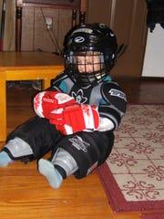 Bella Pauldine wears her brother Riley's gear in 2006.
