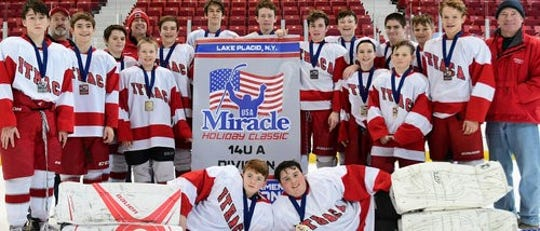 The Miracle Holiday Classic in Lake Placid is a popular tournament the Ithaca Youth Hockey Association has comped in. The Ithaca bantam team pictured won the tournament. Seven of the players pictured now play on the IHS varsity team.