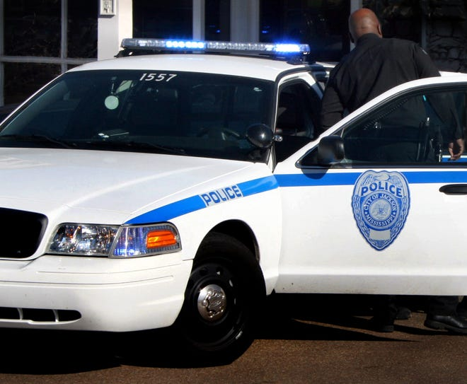 A Jackson police officer and patrol car are shown in this file photo.