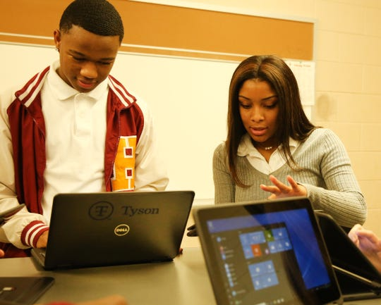 Humboldt High School students Trent Green (left) and Skylar Gibson (right) look at the new computers donated by Tyson. Tuesday, Dec. 11, 2018. Pam Dietz/Jackson Sun