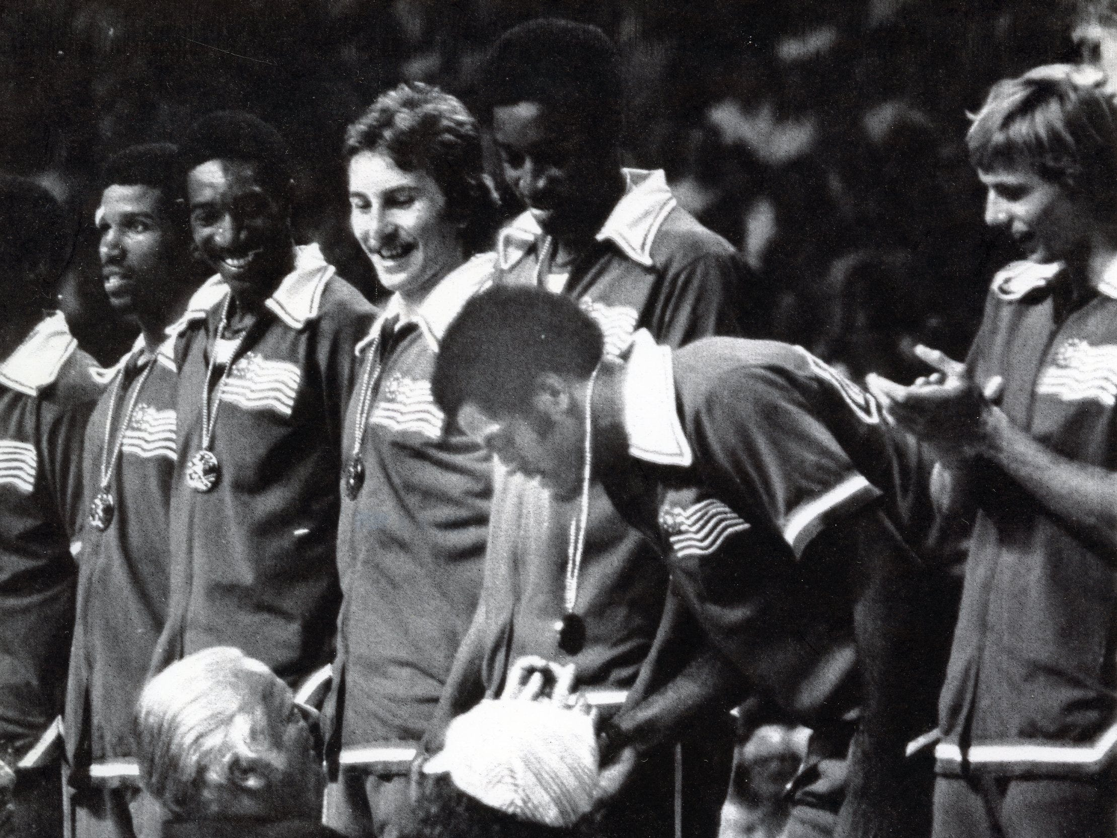 Members of the 1976 Olympic mens basketball team receive their gold medals from IOC president Lord Killanin after defeating Yugoslavia on July 27, 1976. Ernie Grunfeld is pictured third from left.