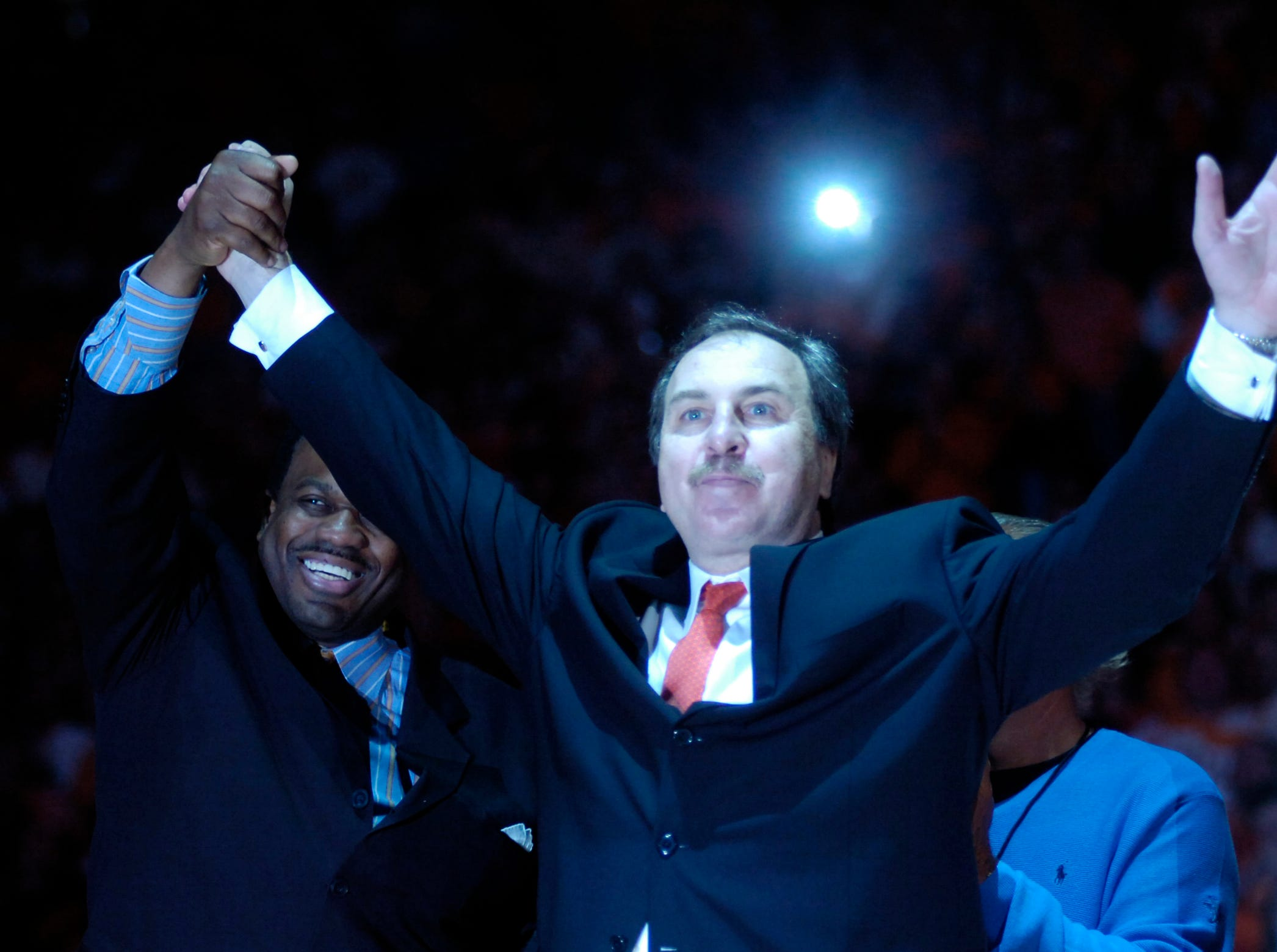 Former Tennessee players Bernard King, left, and Ernie Grunfeld greet the crowd at Thompson-Boling Arena Sunday as Tennessee retired Grunfeld's number during half time of Tennessee's game against Kentucky. Tennessee beats Kentucky 63-60 at Thompson-Boling Arena Sunday.