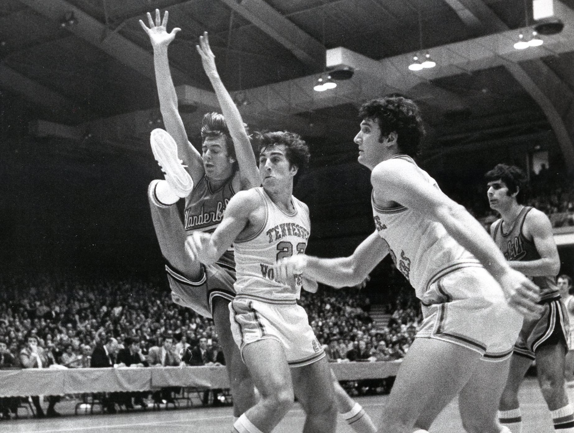 Ernie Grunfeld of UT, center, reacts as a Vanderbilt player lets go of the basketball in this January, 1974 game.