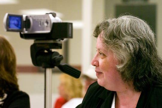 Open government activist Pat Hunter records a meeting of the Loudon County school board.