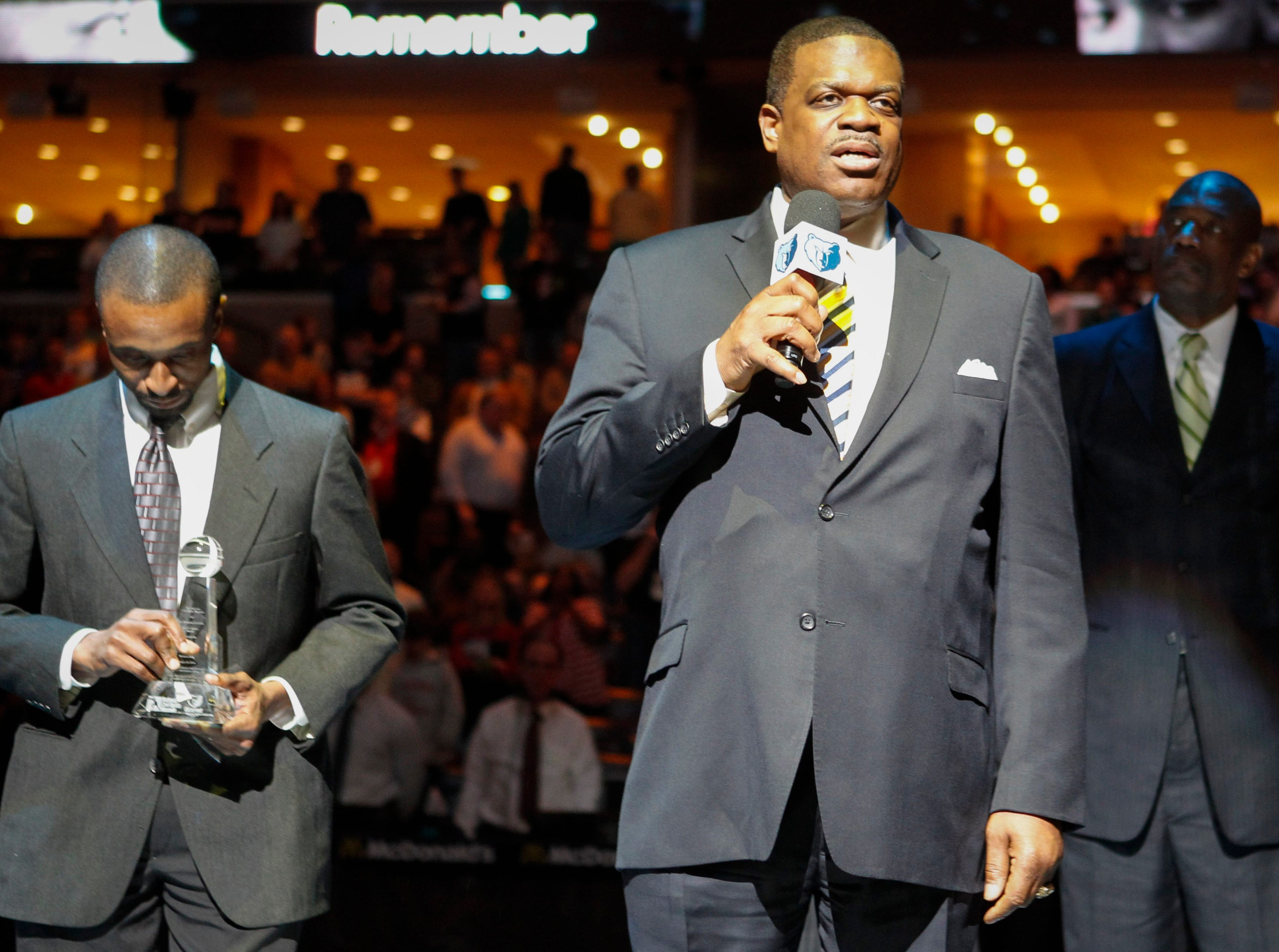 Bernard King accepts the National Civil Rights Sports Legacy Awards, with Jojo White and Dikembe Mutombo before the start of the New Orleans Pelicans against Memphis Grizzlies NBA basketball game, Monday, Jan. 20, 2014, in Memphis, Tenn. (AP Photo/Lance Murphey)