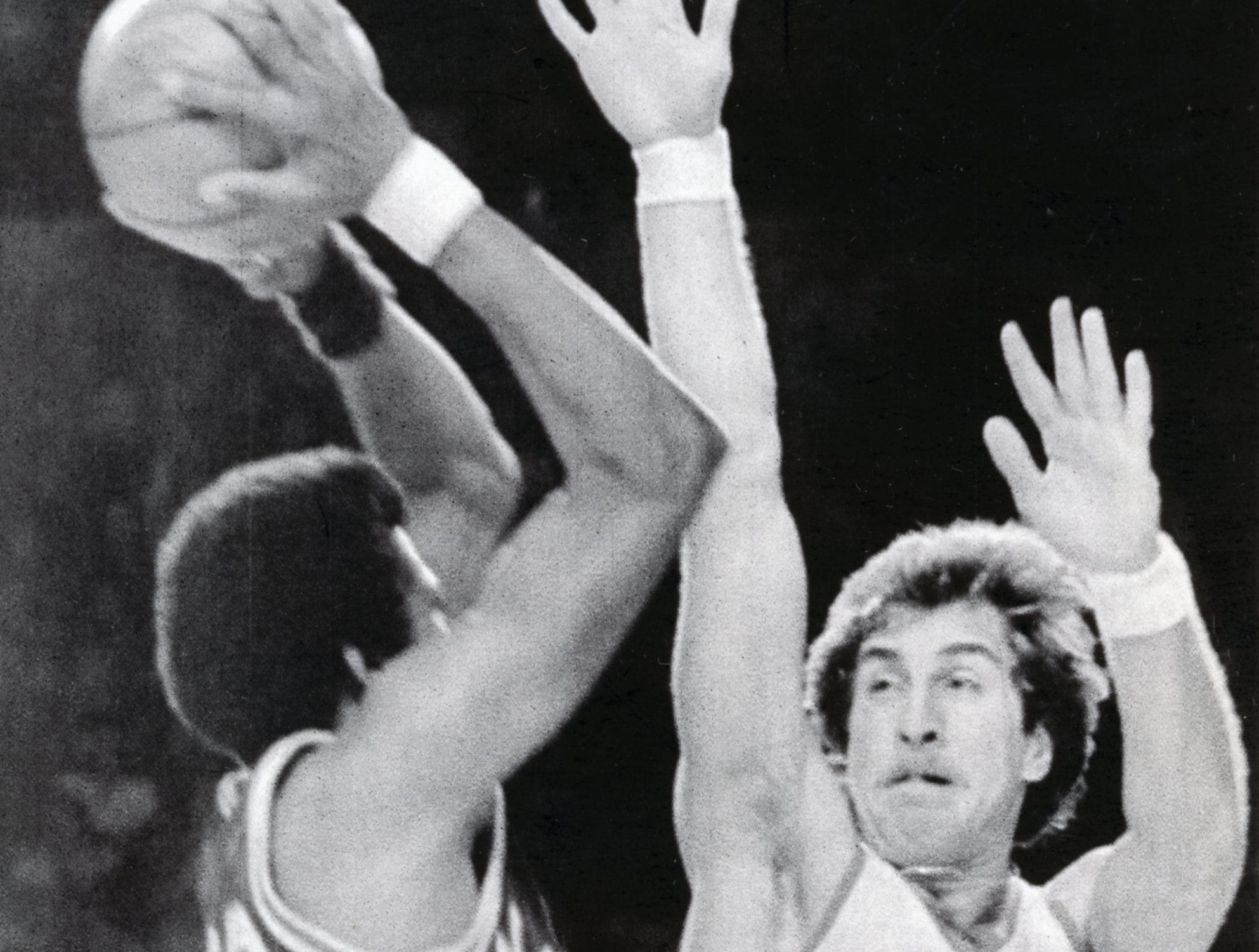 Milwaukee Bucks' Ernie Grunfeld attempts to block a shot during a game against Kansas City Kings, November, 1977.