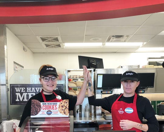 """Megan McLemore and co-worker, Jen Westberry were so excited to serve the rush of the first fifty customers that they paused to high-five each other. """"I trained at the Emory Road location, but this is my very first job,"""" said McLemore."""