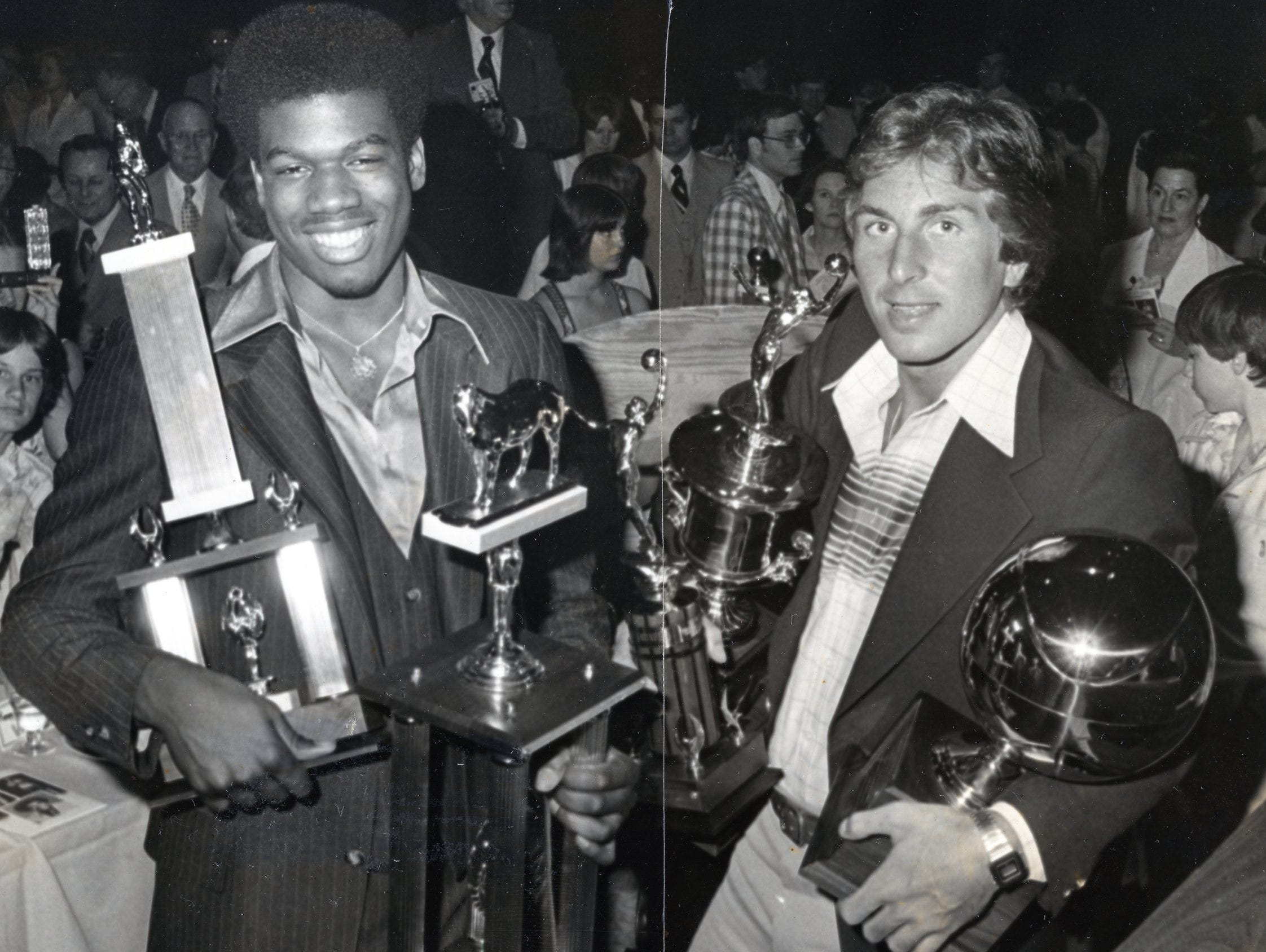 Bernard King and Ernie Grunfeld hold their awards earned while playing basketball at The University of Tennessee.