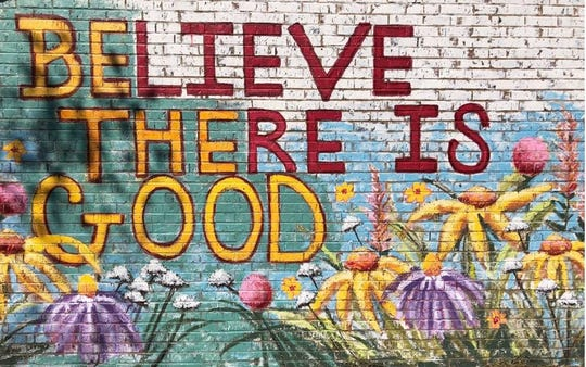 """""""Olivia is living our motto of Being the Good you want to see in the world,"""" says The Village Mercantile owner/operator Monica Lauber. The mural by Christian Freeman is shown outside the store on Walker Boulevard, behind Buddy's Bar-B-Q on North Broadway. November, 2018."""