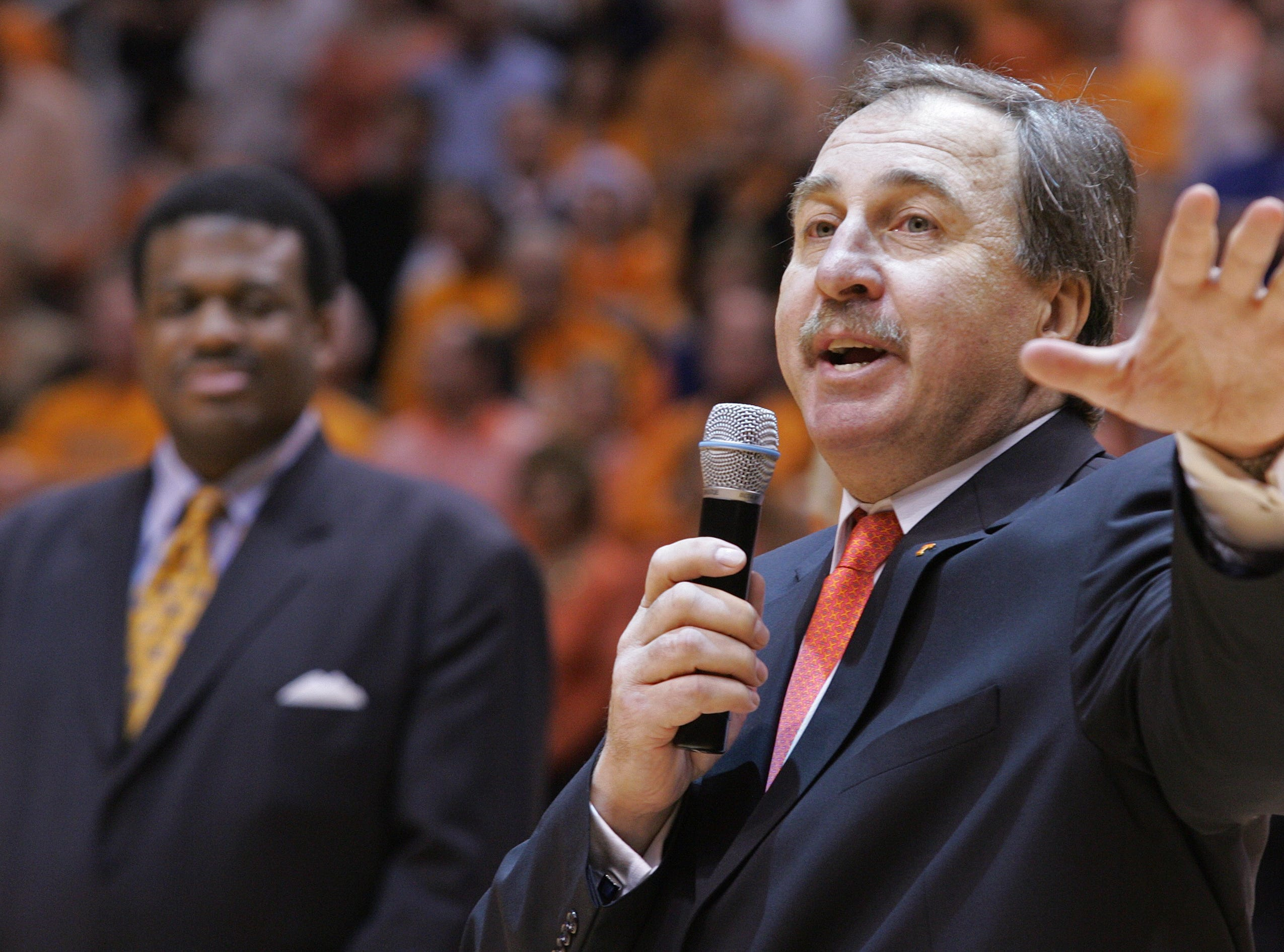 ** CORRECTS TO GRUNFELD NOT GRUFELD ** Former Tennessee player Ernie Grunfeld speaks during halftime of a college basketball game against Kentucky, Saturday, March 2, 2008, in Knoxville, Tenn. Grunfeld's jersey will be retired. Behind him is former teammate Bernard King who's jersey was retired in 2006.