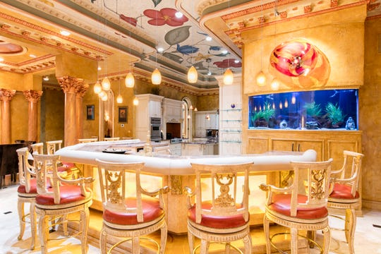 The kitchen and bar area includes a giant exotic aquarium.