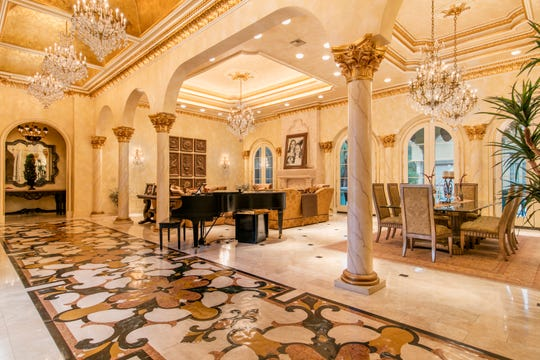 The luxurious finishes include numerous crystal chandeliers and imported marble flooring.