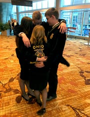 Noah Smith, Paige Hinton, Emma Dearth and Aaron Sharp celebrate after receiving their gold rating at the national contest. They were members of the Agricultural Communications team.