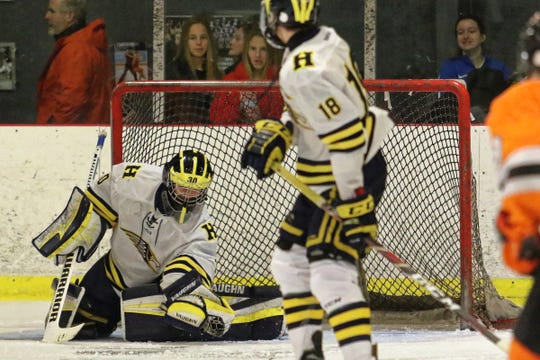 Hartland goalie Brett Tome makes one of his eight saves in an 8-0 shutout of Northville on Wednesday, Dec. 12, 2018 at Hartland Sports Center.