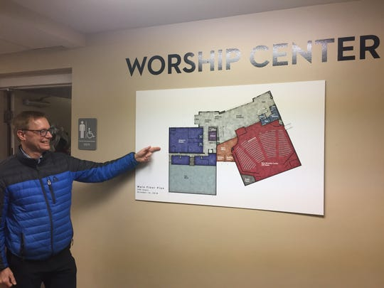 Associate pastor Reed Heckmann discusses plans to expand the church, build a 600-seat auditorium and add other rooms to the building in Genoa Township, seen Thursday, Dec. 13, 2018
